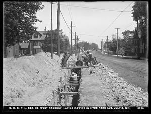 Distribution Department, Southern High Service Pipe Lines, Section 39, laying 24-inch pipe in Hyde Park Avenue, West Roxbury, Mass., Jul. 8, 1911