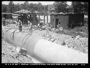 Distribution Department, Weston Aqueduct Supply Lines, Section 7, cleaning 80-inch steel pipe with sand blast, Newton, Mass., Jul. 25, 1911