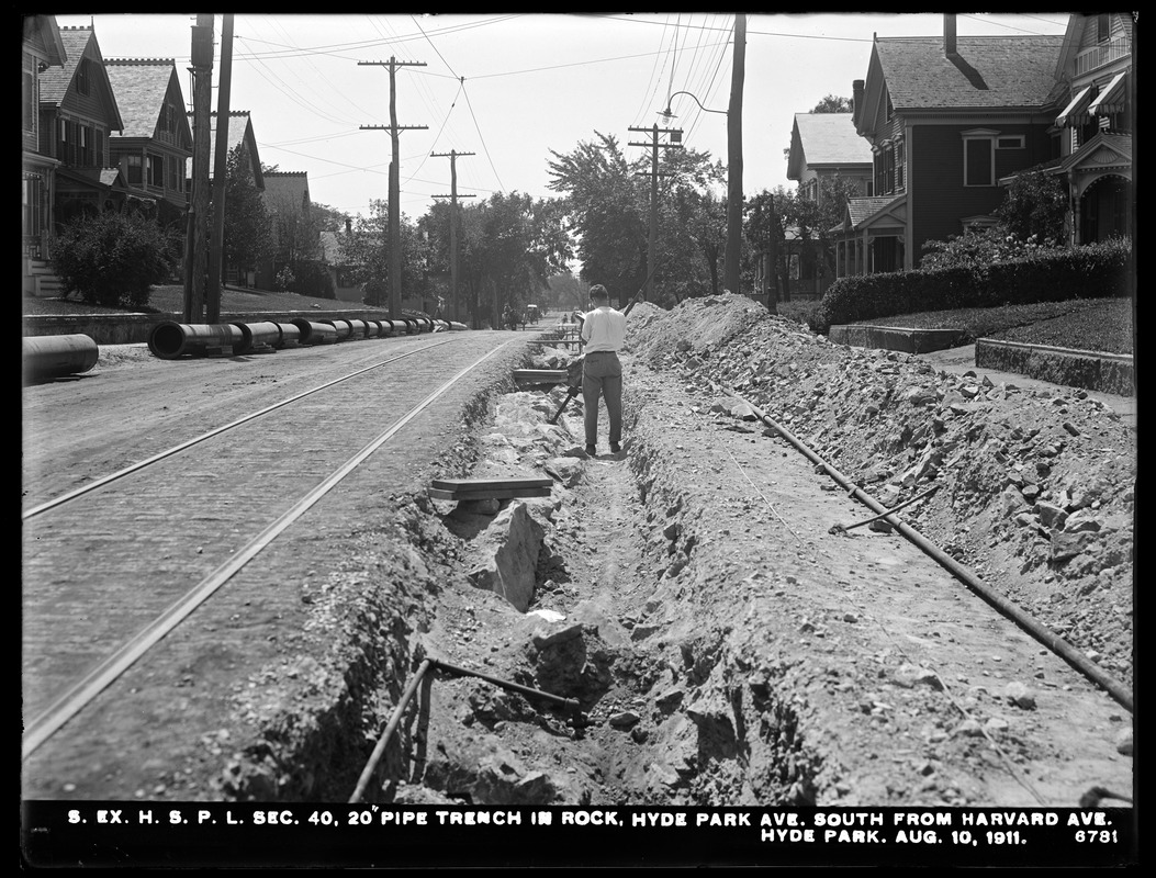 Distribution Department, Southern Extra High Service Pipe Lines, Section 40, 20-inch pipe trench in rock, Hyde Park Avenue, south from Harvard Avenue, Hyde Park, Mass., Aug. 10, 1911