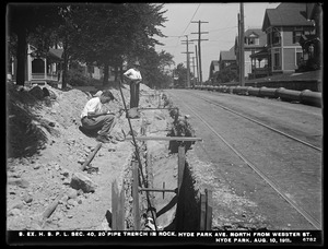 Distribution Department, Southern Extra High Service Pipe Lines, Section 40, 20-inch pipe trench in rock, Hyde Park Avenue, north from Webster Street, Hyde Park, Mass., Aug. 10, 1911