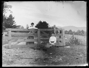 2 women by pasture gate