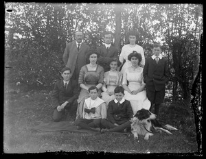 Family portrait outdoors complete with dog