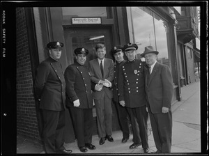 JFK with Somerville cops in front of the Somerville Press during Senate campaign