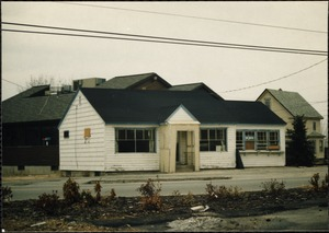 Wooden building with three boarded-up windows