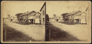 Rural town with unidentified men standing on a distant porch