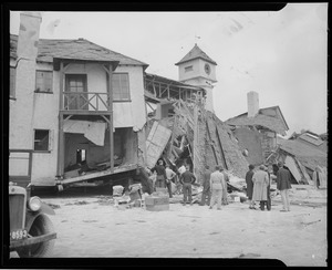 Men examine wrecked building, Hurricane of 38