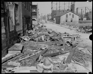 Debris in street near gas tanks, Hurricane of 38