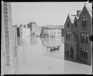Rowboat on flooded city street, Hurricane of 38