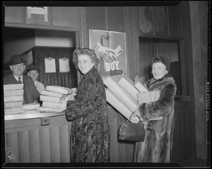 Ladies deliver package at South Station postal annex during Christmas rush