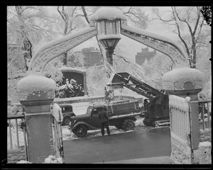 Crews cleaning snow off Beacon Street in front of State House