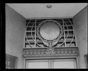 Globe over door at the First National Bank, Canal Street