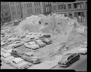 Autos parked in lot left by demolished building