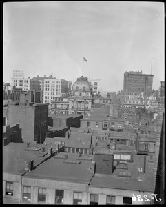 Bird's eye view over Boston rooftops showing City Hall