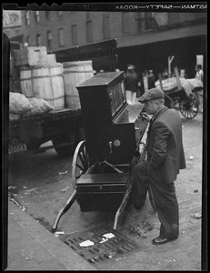 Vendor and cart, busy Quincy Market