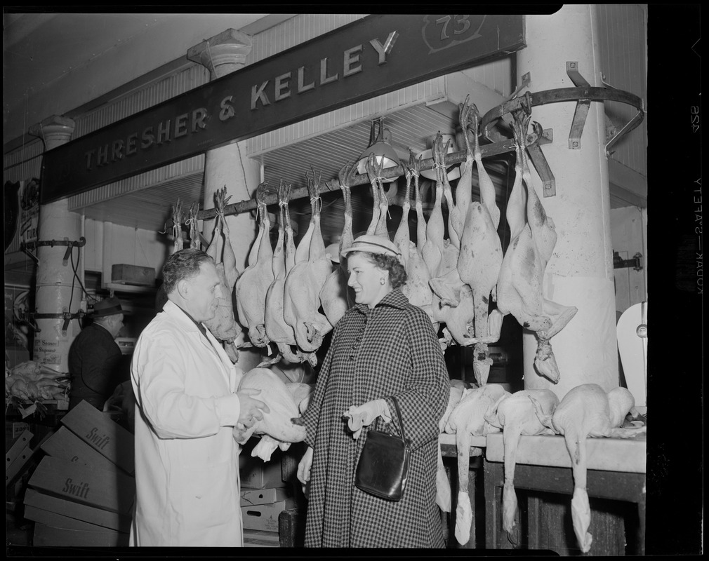 Mr. Kelley selling a Thanksgiving turkey, Thresher & Kelley Market, Faneuil Hall