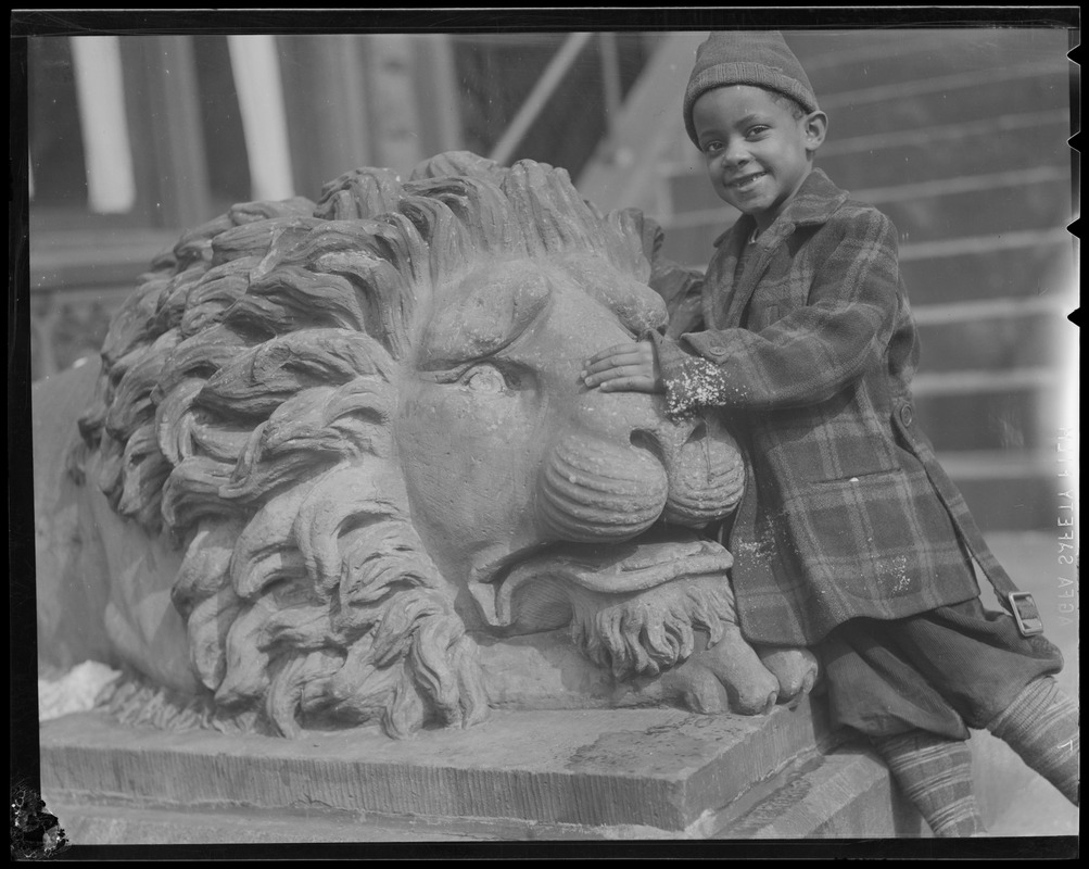 African-American boy with Stowe lion, South End, 511 Columbus Ave.