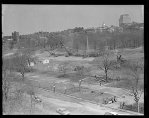 Boston Common: Playground from above showing the start of the underground garage showing mounds of sand