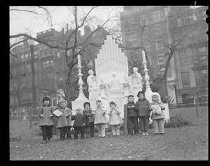 Children in front of Christmas display, Boston Common