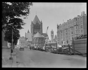 Garage on Stuart St. being constructed, Trinity Church in background