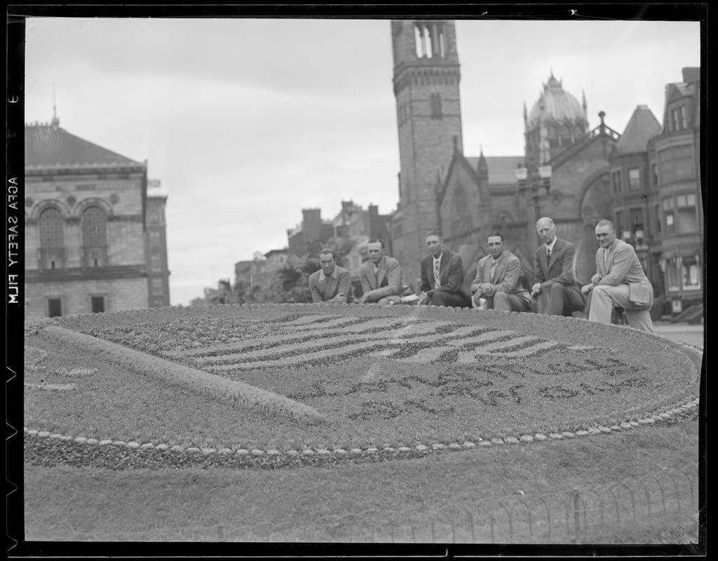 """Floral design in Copley Square showing American flag, """"Long may it wave"""""""