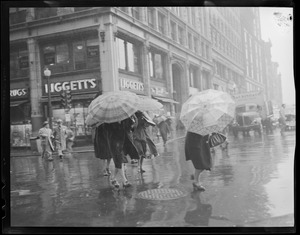 """The Windy Corner"" of Tremont and Boylston during spring shower"