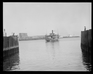 "Last trip of the East Boston ferry ""Penny"", Eastern Ave. slip, Harbor (2), ""Chas C. Donohue,"" East Boston in background"