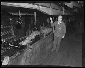 Charlestown Navy Yard/rope making, head man, Charles Leary, employed for 39 years in the rope walk - watching the threads passing through the tar trough.