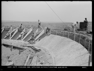 Distribution Department, Chelsea Reservoir, applying asphalt coating, Chelsea, Mass., Aug. 29, 1904