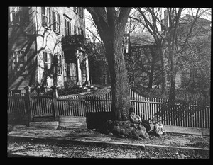 Front of Kettell house on Chestnut Street with tramp resting under tree