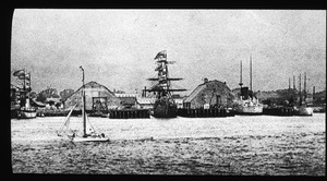 U.S. Navy Yard, with two ships houses and five ships in 1900