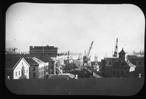 Navy Yard shops and waterfront as seen from Mystic Bridge. Dec. '49.