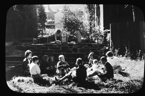 Back yard picnic, St. John's Girls' Choir, plus a couple of younger brothers, enjoy outdoor lunch on grass of Forest Garden, October 6, 1956