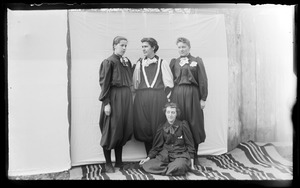 Four female Normal School students in gym uniforms