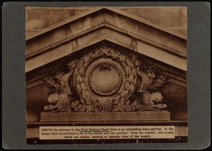 Ornate pediment with wreath cartouche and dolphin on each side, above entrance to First National Bank building, New Bedford, MA