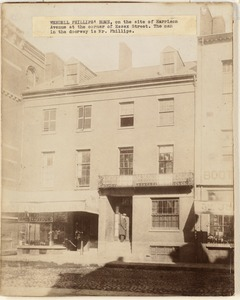 Wendell Philips' home, on the site of Harrison Avenue at the corner of Essex Street. The man in the doorway is Mr. Phillips