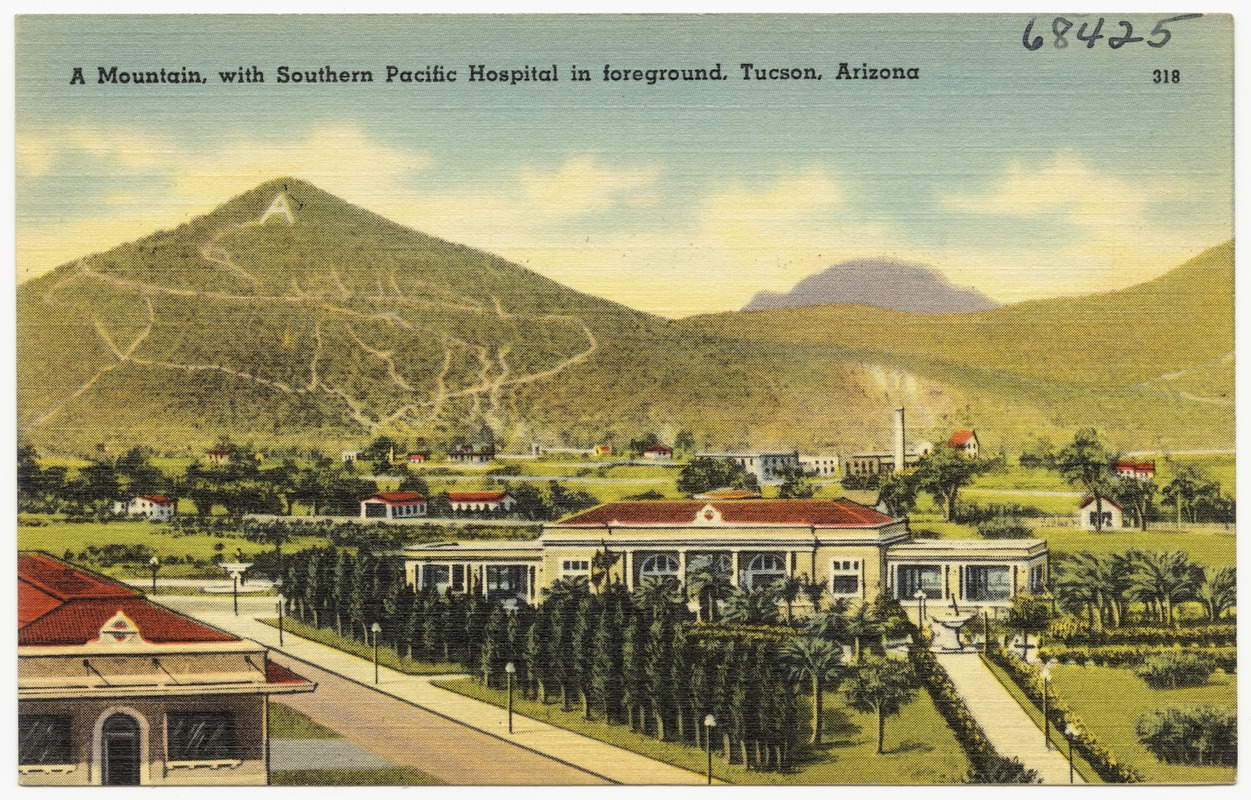 a mountain with southern pacific hospital in fore ground tucson