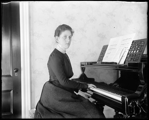 B. Bryant at piano