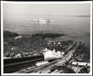 Matinicus Rock, Maine. Visitors (bird lovers) being hauled up the ramp by the Coast Guard