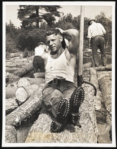 Wide World Photos Boston Bureau Logs go down the oldest logging river in the United States. Biddeford, Maine - Riding logs 90 miles down a river requires special footwear very different from the type used on the ballroom floor. Edward Burrill of Limington, Maine, one of the log drivers on the Saco River is here shown wearing his spiked shoes. The sharp spikes hold on the logs as the wearer runs from one log to another as they float down the river. (see main caption)