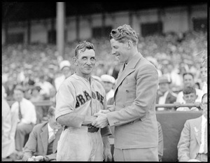 Singer Rudy Vallee visits with Rabbit Maranville at Braves Field