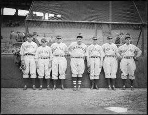Babe Ruth as a Boston Brave poses with Red Sox players
