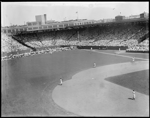Fans in the outfield at Fenway Park