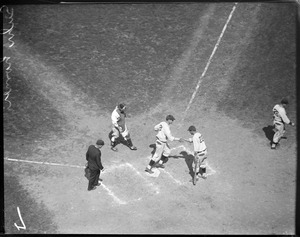 Pittsburgh Pirates Gus Suhr scores against the Boston Braves.