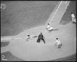 Cleveland player slides in ahead of the tag, Fenway Park