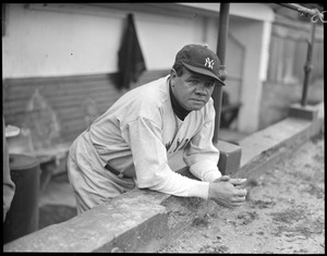 Babe Ruth of the Yankees in dugout at Fenway