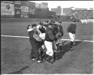 An injured Babe Ruth helped off Fenway Field by Yankee Teammates.
