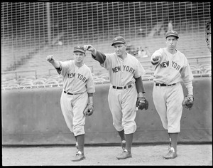Joe DiMaggio and Yankee teammates in throwing pose.