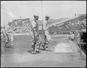 Dizzy Dean of the Cardinals walks to the dugout with his catcher, Braves field