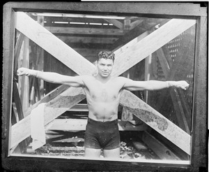 Boxing great Jack Dempsey shows his reach