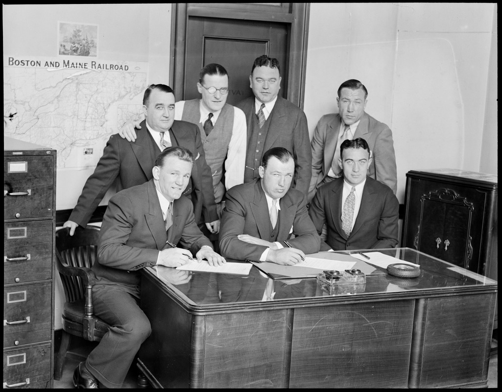 Fighters Ernie Schaaf, Jack Sharkey and Jim Maloney sign on the dotted line for fights at Boston Garden